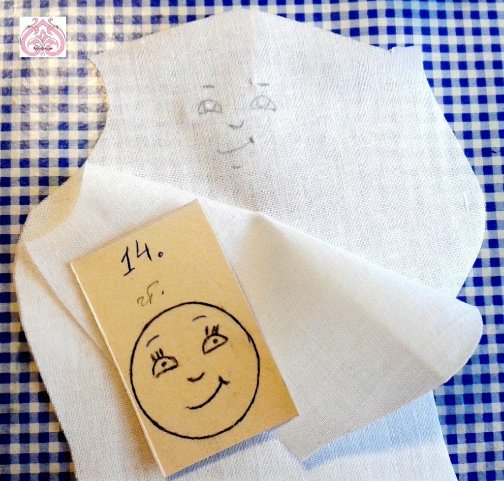 Рисуем карандашом лицо на ткани.
